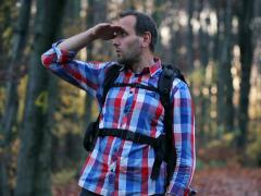 Stock Video Footage of Young, handsome man looking for direction in the forest NTSC
