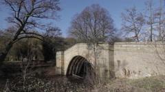 Bridge over Derwent River, Chatsworth Park, Derbyshire, England, Uk, Europe Stock Footage