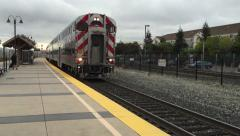 Commuter train pulls into station Stock Footage