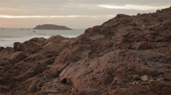 Sunset on the beautiful rocky beach. Very picturesque landscape. Stock Footage