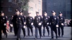 1306 - policemen proudly march in city parade - vintage film home movie Stock Footage