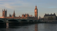 Westminster Bridge, the Big Ben and the Houses of Parliament at sunrise. Stock Footage