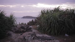Sunset on the beautiful rocky beach, panorama. Very picturesque landscape. Stock Footage