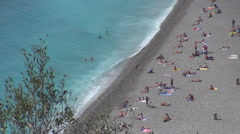 Tilt up pan left Nice beach french riviera luxury resort sunny day tourism city  Stock Footage