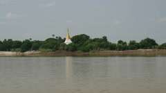 Pagoda with reflection at the Ayeyarwady river side, Myanmar, Burma Stock Footage