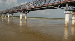 Long bridge over the Ayeyarwady river side, Myanmar, Burma Stock Footage