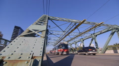 A streetcar drives over a bridge in Toronto Stock Footage