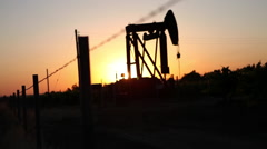 Sunset Oil Rig - stock footage