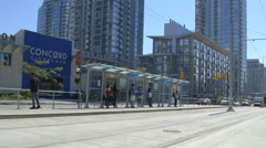 Commuters wait for a Streetcar in Downtown Toronto - New Streetcar Stock Footage