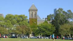 STUDENTS PLAY SPORTS ON UNIVERSITY CAMPUS Stock Footage