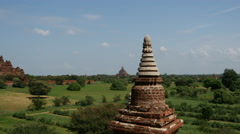 Tilt from a pagoda to the Dhammayan Gyi Temple in Bagan, Myanmar, Burma Stock Footage