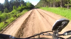 Mountain Biking on a Dirt Road Stock Footage