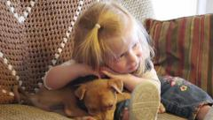 toddler girl adores puppy - stock footage