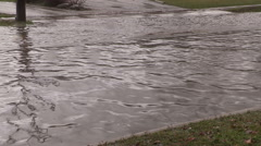Raging river in flood after severe weather and heavy rain storm Stock Footage