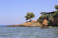 Tavern on the Aegean coast. - stock photo