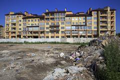 Garbage dump near the elite district Stargorod in Omsk. Stock Photos