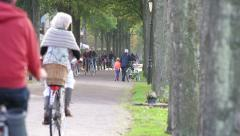 Busy road with bicycles at a netherland village. Stock Footage