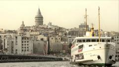 Public ferry is landing to harbor at sunset, Istanbul Stock Footage