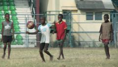 African boys playing soccer Stock Footage