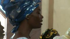 Woman singing and clapping in African church - stock footage
