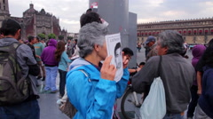 Woman shows a banner in a march protest for the disappeared in Ayotzinapa. Stock Footage
