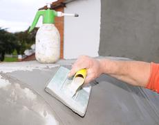 construction worker plastering an old wall.. - stock photo