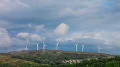 Wind turbine generators on top of a hill - stock footage