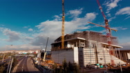 Stock Video Footage of 4K city, construction site with cranes, wide view highway timelapse