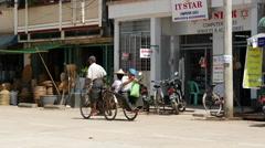 Traffic in the street of Pathein, Myanmar, Burma Stock Footage