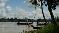 Small boats in front of the skyline from Pathein, Myanmar, Burma Stock Footage