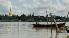 Small boat in front of the skyline from Pathein, Myanmar, Burma Stock Footage