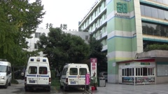 Footage of a medical center with ambulances in front, Chengdu, Sichuan, China Stock Footage
