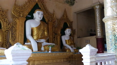 Pan from Buddha statues at the Shwemokehtaw Pagoda in Pathein, Myanmar, Burma Stock Footage