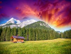Alpin Hut with meadows, trees and mountain peaks - Summer colors Stock Photos