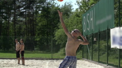 Man gave a beautiful upper serve at valley-ball Stock Footage