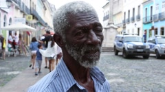 "The famous man called ""Pele"" sells gifts to tourists at Pelourinho in Salvador Stock Footage"