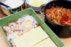 Preparation of lasagna Stock Photos