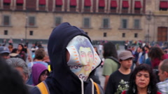 Man cover his face with a drawing of one student disappeared in Ayotzinapa. Stock Footage