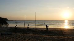 People playing volleybal during sunset at Ngwe Saung Beach, Myanmar, Burma Stock Footage