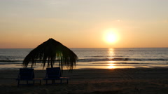 Sunset at Ngwe Saung Beach with beach chairs and parasol, Myanmar, Burma Stock Footage