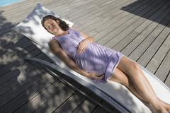 High angle view of a woman resting on a deck chair Stock Photos
