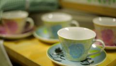 Tracking Shot Past Tea Cups Stock Footage