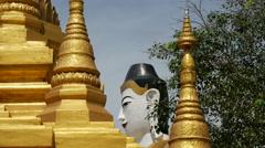 Buddha statue behind a pagoda in Pathein, Myanmar, Burma Stock Footage