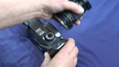 Changing lens on a medium format camera Stock Footage