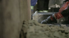 Worker chipping away concrete with jackhammer Stock Footage