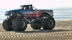 Bigfoot Pick-Up Monster Truck Revving It Up On The Beach Stock Footage
