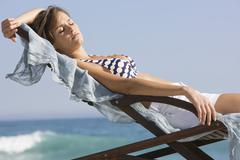 Woman resting in a deck chair - stock photo