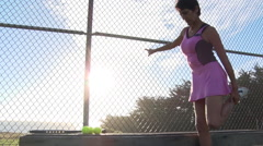 Woman playing tennis- stretching -1080p ProRes422 Stock Footage