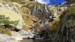 Beautiful veil cascading waterfall, mossy rocks Stock Footage