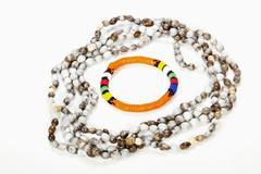 beaded zulu necklace with bright orange armband - stock photo